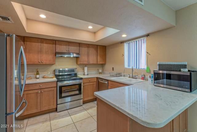 4303 E Cactus Road #103, Phoenix, AZ 85032 (MLS #6292416) :: Executive Realty Advisors