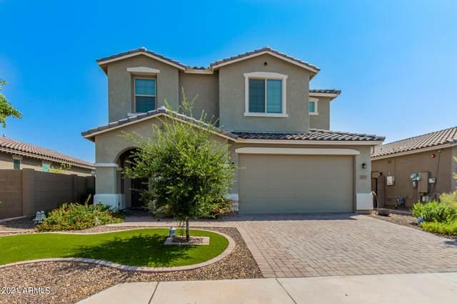1785 N 211TH Drive, Buckeye, AZ 85396 (MLS #6294038) :: Power Realty Group Model Home Center