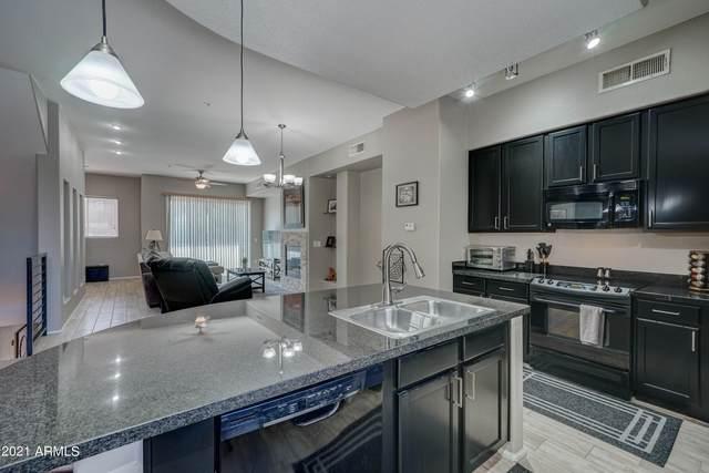 6745 N 93RD Avenue #1112, Glendale, AZ 85305 (MLS #6295765) :: Yost Realty Group at RE/MAX Casa Grande