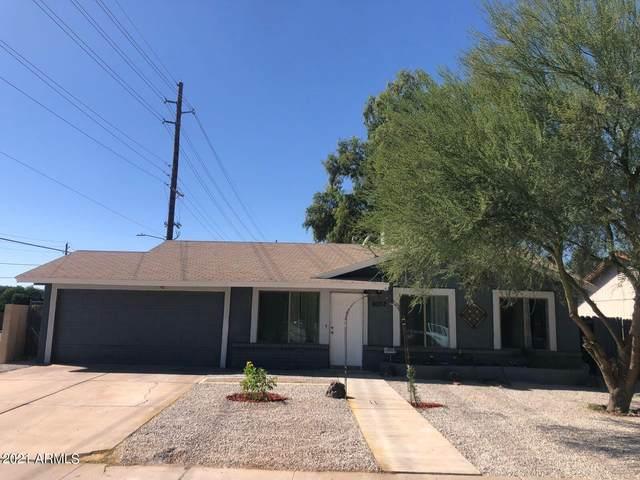 8002 N 42ND Avenue, Phoenix, AZ 85051 (MLS #6306918) :: Yost Realty Group at RE/MAX Casa Grande