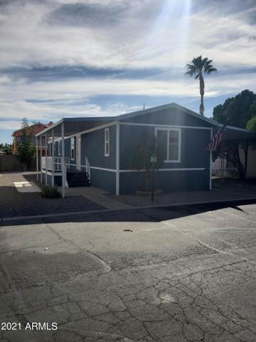 19602 N 32nd Street N #121, Phoenix, AZ 85050 (MLS #6311894) :: Openshaw Real Estate Group in partnership with The Jesse Herfel Real Estate Group