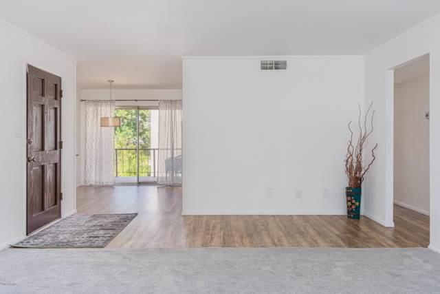 4201 E Camelback Road #56, Phoenix, AZ 85018 (MLS #5981396) :: The Bill and Cindy Flowers Team