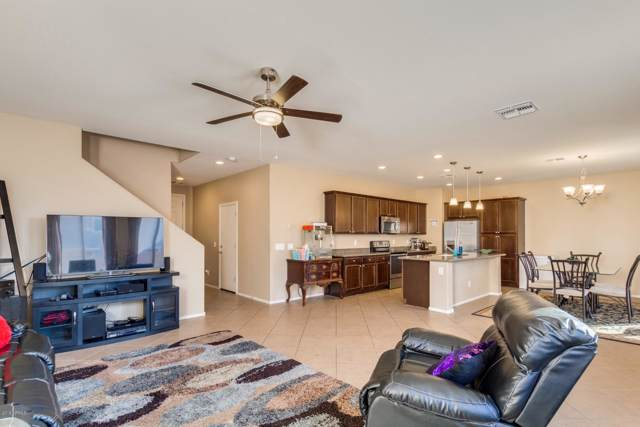 12131 W Rowel Road, Peoria, AZ 85383 (MLS #5989621) :: Lucido Agency
