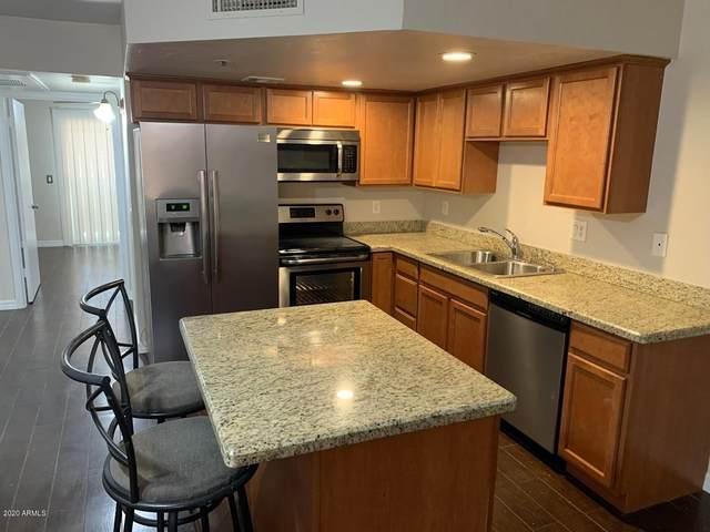 12221 W Bell Road #242, Surprise, AZ 85378 (MLS #6076230) :: Brett Tanner Home Selling Team