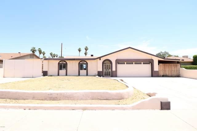 16233 N 43RD Drive, Glendale, AZ 85306 (MLS #6085689) :: Devor Real Estate Associates