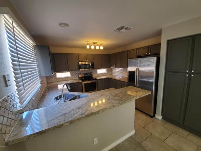 11250 W Roma Avenue, Phoenix, AZ 85037 (MLS #6086765) :: Klaus Team Real Estate Solutions