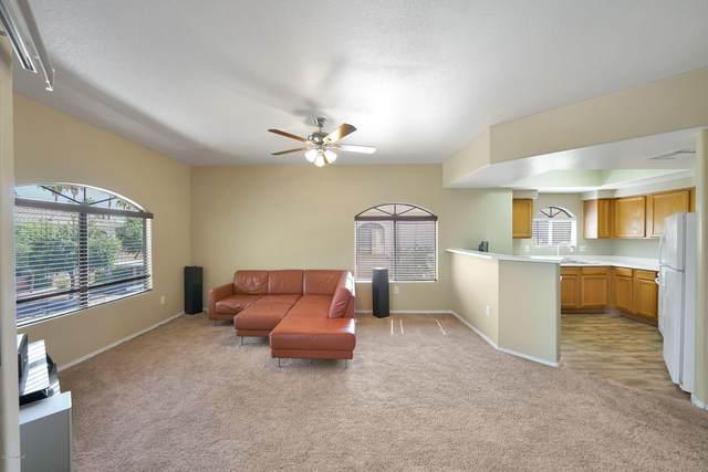 10030 W Indian School Road #264, Phoenix, AZ 85037 (MLS #6093496) :: Brett Tanner Home Selling Team