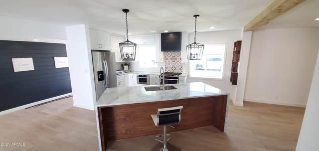 1108 E Stella Lane, Phoenix, AZ 85014 (MLS #6195548) :: Yost Realty Group at RE/MAX Casa Grande