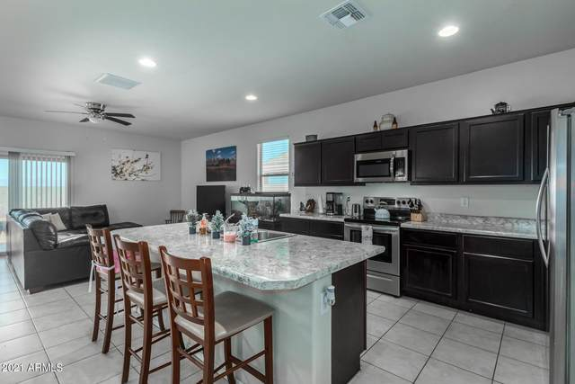 11410 E Aster Lane, Florence, AZ 85132 (MLS #6218213) :: Yost Realty Group at RE/MAX Casa Grande