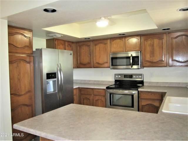 12222 N Paradise Village Parkway #303, Phoenix, AZ 85032 (MLS #6226655) :: The Garcia Group