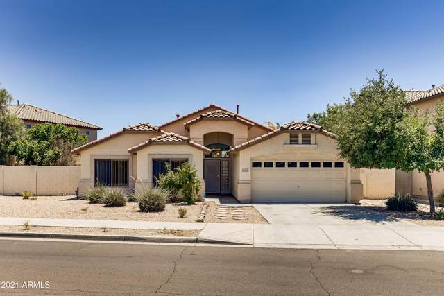 16423 W Woodlands Avenue, Goodyear, AZ 85338 (MLS #6248961) :: Yost Realty Group at RE/MAX Casa Grande