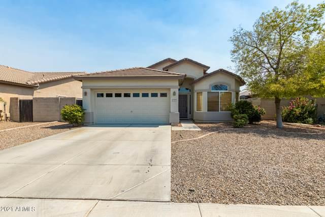 11929 W Madison Street, Avondale, AZ 85323 (MLS #6252338) :: Yost Realty Group at RE/MAX Casa Grande