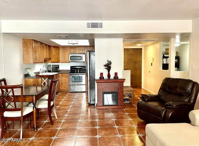 7940 E Camelback Road A204, Scottsdale, AZ 85251 (MLS #6257527) :: Long Realty West Valley