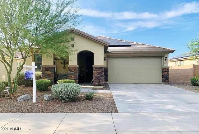 18036 W Thistle Landing Drive, Goodyear, AZ 85338 (MLS #6266067) :: Yost Realty Group at RE/MAX Casa Grande