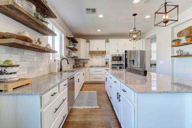 31976 N 132ND Drive, Peoria, AZ 85383 (MLS #5868134) :: Kortright Group - West USA Realty
