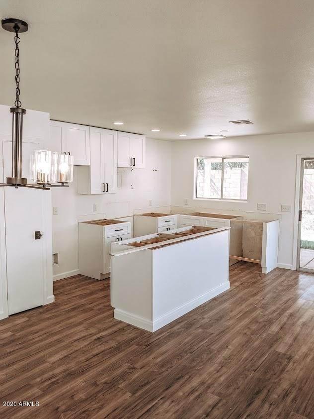 2856 W Angela Drive, Phoenix, AZ 85053 (MLS #6111694) :: Devor Real Estate Associates