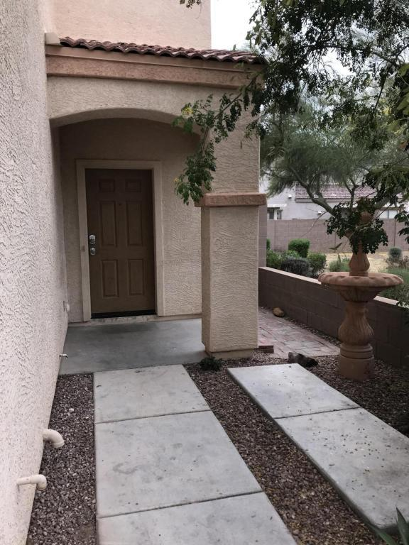 7055 W Lincoln Street, Peoria, AZ 85345 (MLS #5754633) :: Kelly Cook Real Estate Group