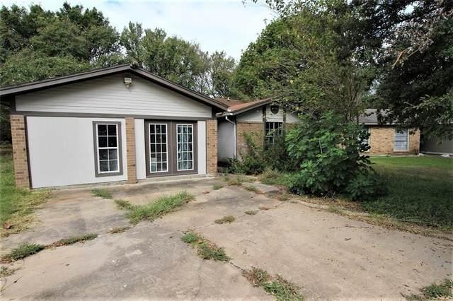 7814 Paces Mill Ln, Austin, TX 78744 (#4179402) :: Cord Shiflet Group