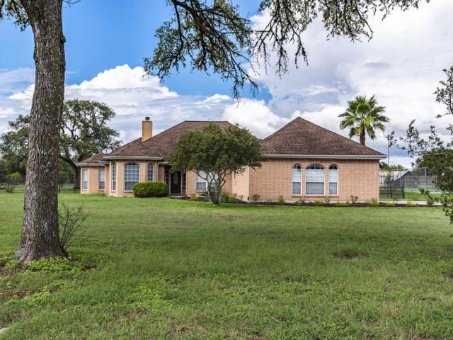 320 Woodland Oaks Trl, Buda, TX 78610 (#5752712) :: The Perry Henderson Group at Berkshire Hathaway Texas Realty