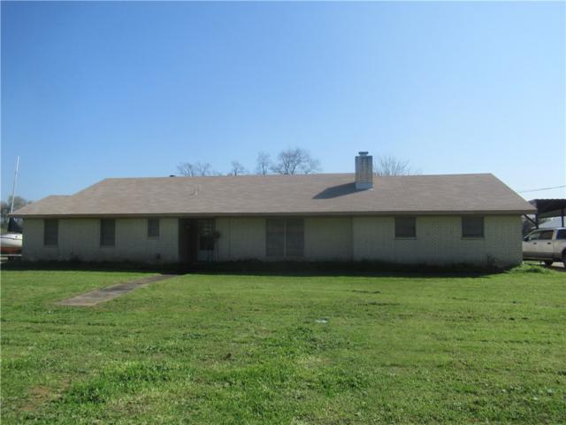 1406 NE 7th St, Smithville, TX 78957 (#6200388) :: The Heyl Group at Keller Williams