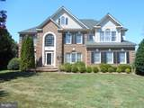 8900 Grist Mill Woods Court - Photo 1