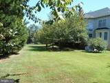 8900 Grist Mill Woods Court - Photo 27