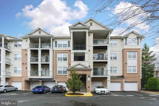 12120 Garden Ridge Lane #202, FAIRFAX, VA 22030 (#VAFX1120380) :: Bic DeCaro & Associates