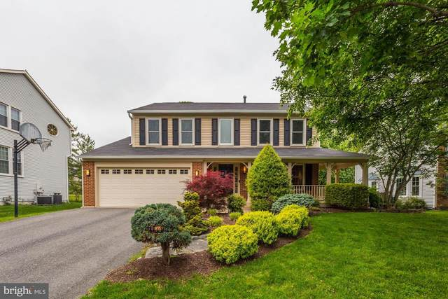 14407 Sylvan Glade Drive, NORTH POTOMAC, MD 20878 (#MDMC708000) :: Mortensen Team