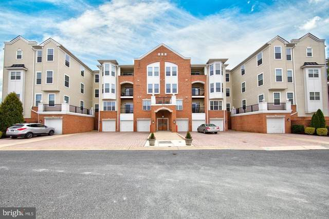 8615 Wandering Fox Trail #305, ODENTON, MD 21113 (#MDAA447842) :: Crossman & Co. Real Estate