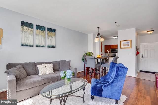 1200 Braddock Place #105, ALEXANDRIA, VA 22314 (#VAAX256712) :: Nesbitt Realty
