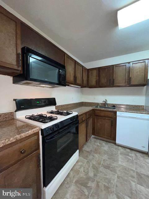 4414 Island Place #204, ANNANDALE, VA 22003 (#VAFX1200710) :: Corner House Realty