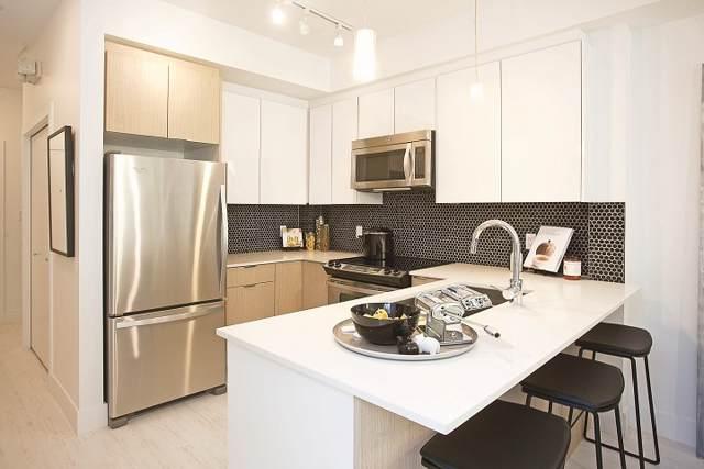 19567 64 Avenue #307, Surrey, BC V4N 6J7 (#R2418723) :: Macdonald Realty