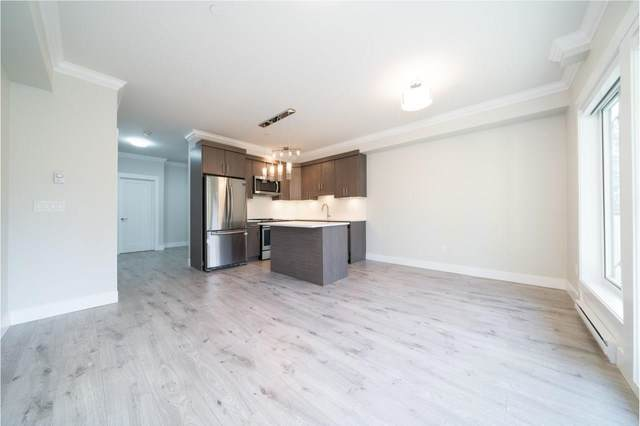 13799 101 Avenue #408, Surrey, BC V3T 0N9 (#R2586523) :: Premiere Property Marketing Team
