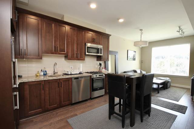 5011 Springs Boulevard #202, Delta, BC V4M 0B6 (#R2600553) :: Initia Real Estate