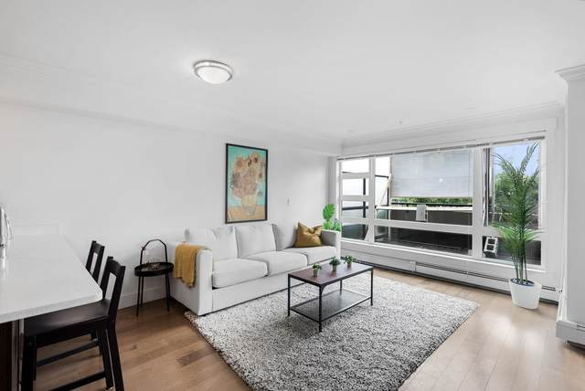 857 W 15TH Street #205, North Vancouver, BC V7P 1M5 (#R2600752) :: Initia Real Estate