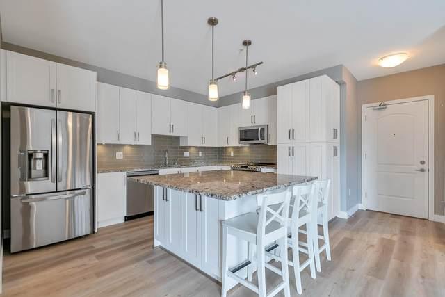 6490 194 Street #302, Surrey, BC V4N 6J9 (#R2603890) :: Initia Real Estate