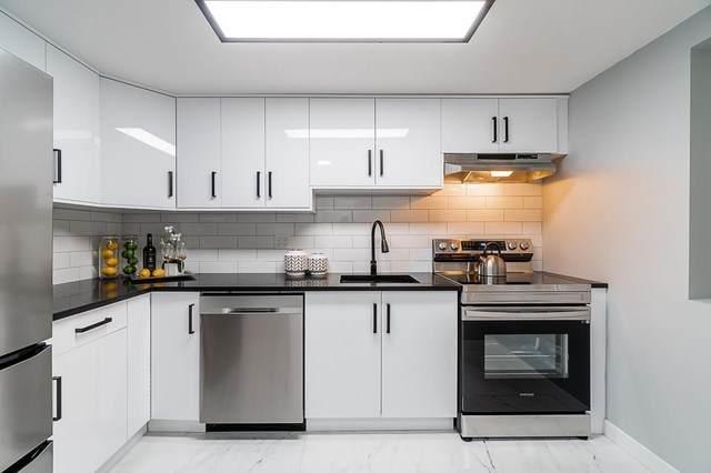 8068 120A Street #308, Surrey, BC V3W 3P3 (#R2626352) :: 604 Home Group