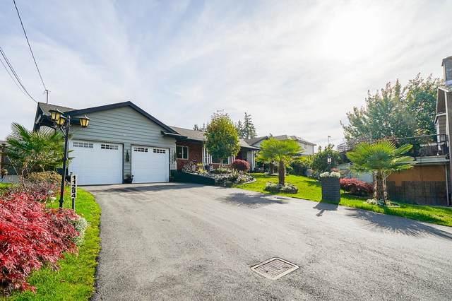 11284 86A Avenue, Delta, BC V4C 2Y6 (#R2627377) :: Macdonald Realty