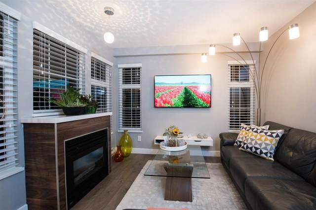 5518 14 Avenue #303, Delta, BC V4M 4E9 (#R2501814) :: Initia Real Estate