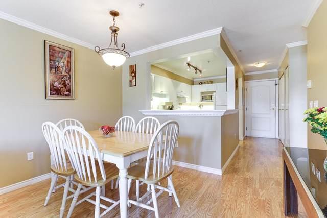 1669 Grant Avenue #408, Port Coquitlam, BC V3B 7W9 (#R2598414) :: Initia Real Estate
