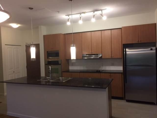 15322 101 Avenue #202, Surrey, BC V3R 4G9 (#R2423590) :: Premiere Property Marketing Team