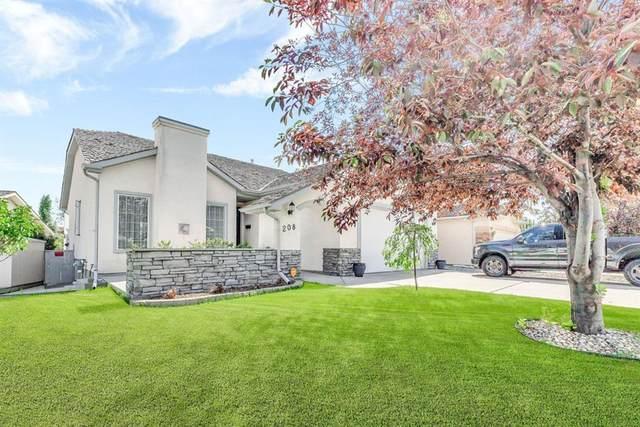 208 Harvest Grove Place NE, Calgary, AB T3K 5B3 (#A1011366) :: Redline Real Estate Group Inc