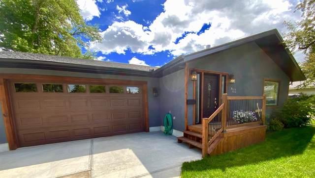 82 Hallbrook Drive SW, Calgary, AB  (#A1012206) :: Redline Real Estate Group Inc