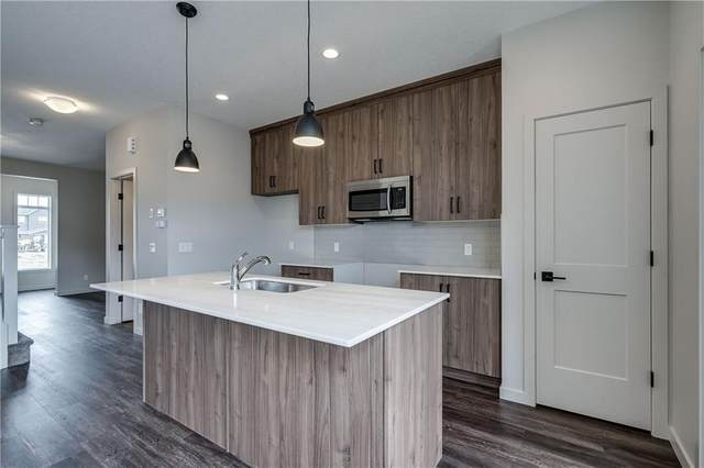 23 Emberside Hollow, Cochrane, AB T4C 2L6 (#A1012680) :: Redline Real Estate Group Inc