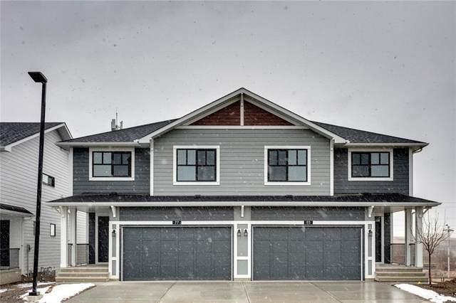 75 Harvest Grove Common NE, Calgary, AB T3K 4T6 (#A1013205) :: Redline Real Estate Group Inc