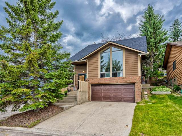 227 Coach Side Road SW, Calgary, AB T3H 1L6 (#A1013657) :: Redline Real Estate Group Inc