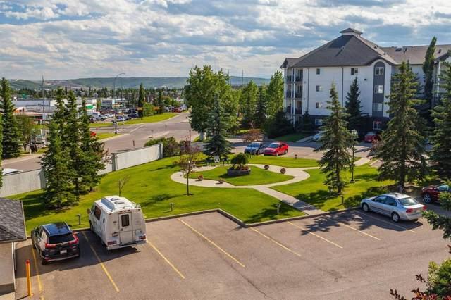 55 Arbour Grove Close NW #407, Calgary, AB T3G 4K3 (#A1015992) :: Redline Real Estate Group Inc