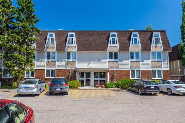 332 Cedar Crescent SW #303, Calgary, AB T3C 2Y8 (#A1016864) :: Redline Real Estate Group Inc