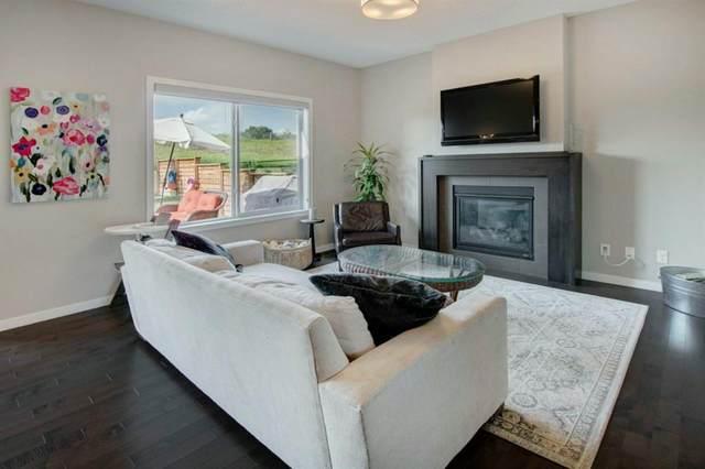 143 Fireside Cove, Cochrane, AB T4C 0X4 (#A1017996) :: Redline Real Estate Group Inc