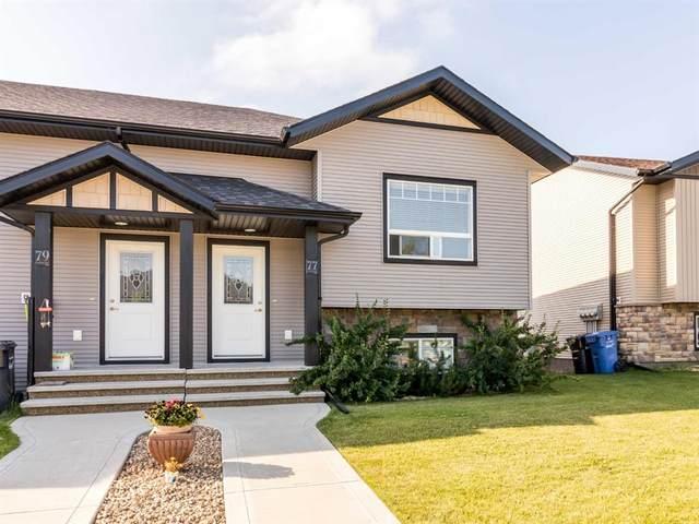 77 Hawkridge Boulevard, Penhold, AB T0M 1R0 (#A1018402) :: Canmore & Banff